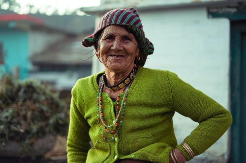 woman-in-green-sweater-smiling-4511649.jpg